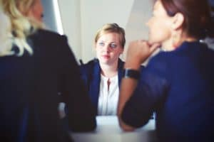 a woman is interviewed for her business skills